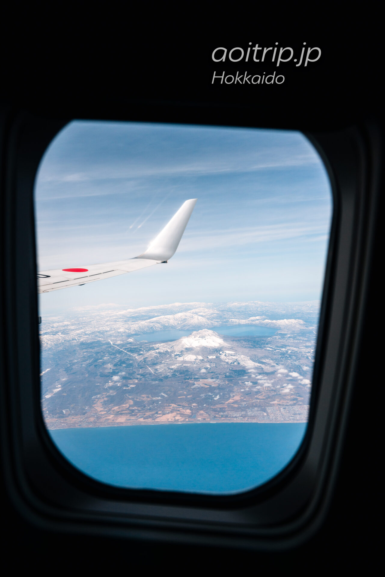 北海道の航空写真 飛行機の窓から 3月 支笏洞爺国立公園の眺望 支笏湖、樽前山、風不死岳、恵庭岳