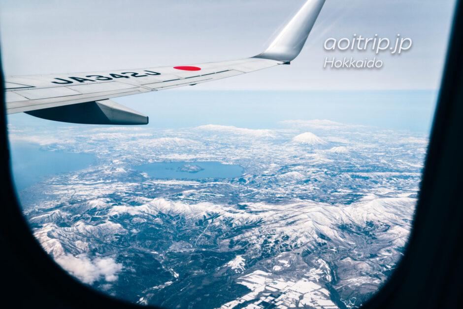 北海道の航空写真 飛行機の窓から 3月 支笏洞爺国立公園の眺望 羊蹄山と洞爺湖
